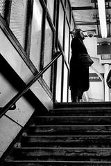 Moth (draketoulouse) Tags: chicago rogerspark cta blackandwhite monochrome people city urban girl stairs light