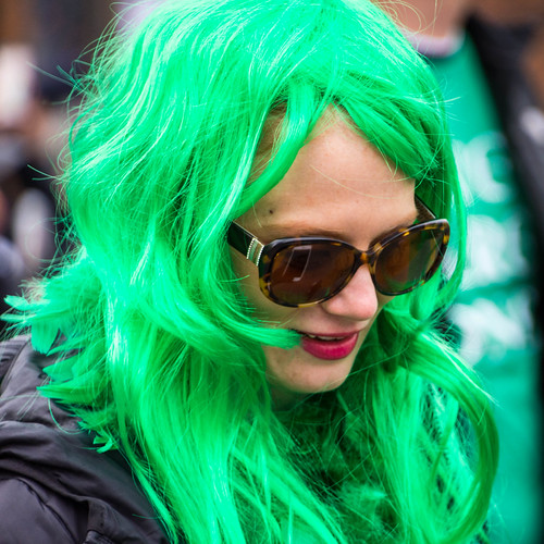 Green-haired lady reads her iPhone