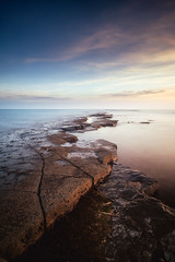 Low Tide at Kimmeridge Bay (tariqphoto) Tags: red low tide kimmeridge bay sunset sun clouds blue sky skies dorset purbeck isle jurassic coast coastline coastal seascape seascapes landscapes landscape long exposure water sea rocks fossils sony a7 zeiss loxia 21mm lee filters nd polariser grad spring 2017