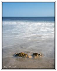 Gold white & blue (Lynne J Photography) Tags: pier sunrise pastel long exposure beach rapeseed dusk sunset chemicalbeach seaham wheels sand steetley dawn colors rocks sidelight
