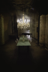 Haunted Dinner Party (Pherit) Tags: 24mm abandoned chandelier cinematic creepy d810 dinner haunted ky kentucky louisville nikon spooky table