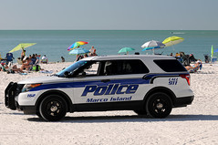 Law and Order (Poocher7) Tags: police law order boysinblue policecar marcoislandpolice 911 beach ocean gulfofmexico loungechairs umbrellas sand