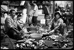 Cambodia - 2536 (- a r a s h -) Tags: cambodia bw market life streetphotography blackwhite fishstall siemreap