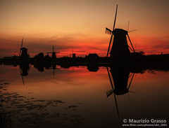 Windmills at Kinderdijk. (UKN_1861) Tags: kinderdijk holland netherlands dutch windmill windmills sunset dusk twilight typical architecture sky copyspace reflection canal river clouds majestic colorful europe tourism touristic tourist attraction landmark famous landscape water view scenery countryside traditional rural mill sunrise outdoor scenic