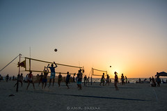 Sunset by the Beach (amirdakkak1) Tags: sunset beach outdoors outdoor volleyball volley sports beachsports sand dubai uae man woman lady men women human people environment waves sea