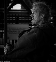 Coffee in the blood. (Neil. Moralee) Tags: canadaneilmoraleenikond7100 neilmoralee man old mature coffee vagrent tramp homeless cold drink sitting canada toronto beard stubble hair dirty alone poverty city candid street black white bandw bw blackandwhite mono monochrome portrait blood nikon d7100 neil moralee coat winter solo down depression destitute illness 18300mm zoom