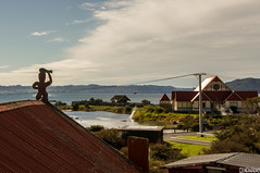 Small Rotorua Village (smellerbee) Tags: rotorua nz newzealand travel roadtrip sky blue roof red maori carving scenic vista town ocean sea seaside lake lakerotorua quiet morning pentax pentaxkr digital colour color