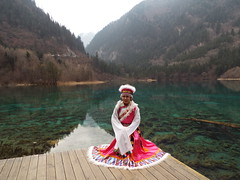 The Bai people (Romane Licour) Tags: sichuan china bai baipeople ethnicminority lady traditionalwearing clothes nationalpark pink white bluelake lake forests mountains