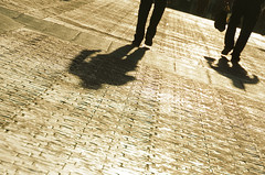 silhouette of business men walking with long shadows (Mimadeo) Tags: street city light sunset shadow people urban sunlight man men silhouette businessman walking outdoors person long ray floor pavement walk business sidewalk busy executive
