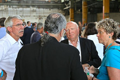 Barnaby Evans discusses plans for WaterFire's new home with Jim Scott (left) and board members Charlie Meyers and Anne Scott