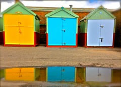 Hove Beach Huts (Kevin Bentman) Tags: iphone iphone5 pic picture pictures snap snaps camera colour colours colourful bright sunny fun funny different special brighton hove brightonandhove flickr 33 kevinbentman amazing reflection reflections beach beachhut huts beachhouse hovelagoon lagoon blue yellow puddle wet