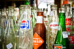 Antique Mall Field Trip (Sneaky Fox Productions) Tags: glass cola bottles antique pop regina saskatchewan coca sask