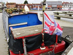 Logs For The Wood Burner (LookaroundAnne) Tags: canal wind flag warwickshire stratford stratforduponavon canalboat itscold thewind