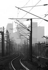 La Defense (6) (julien `) Tags: city urban blackandwhite france train europe gare grain olympus trainstation future rails ladéfense hautsdeseine houilles stylus1