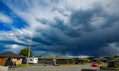 The Storm Spreads Out (Steve Taylor (Photography)) Tags: storm caravan eerie newzealand nz southisland canterbury christchurch northnewbrighton stormy sky cloud