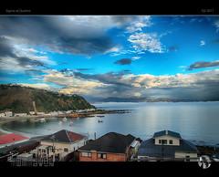 Sea Mist and Stilness (tomraven) Tags: islandbay fb ev 500px tomraven sea coast coastline bay houses clouds sky reflections hills aravenimage q22017 sigma sdquattro