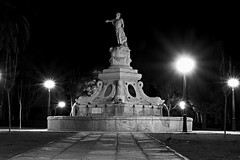 Fountain (Daniel Nebreda Lucea) Tags: fountain fuente night noche city ciudad street calle park parque black white blanco negro monochrome monocromo travel viajar long exposure larga exposicion light luz luces lights shadows sombras architecture arquitectura art arte old antigua neptuno beautifu bonita perspective perspectiva stone piedra building construccion noir canon 60d 50mm zaragoza europe europa spain españa aragon dios god