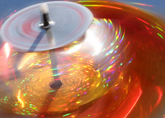 In A Spin (Helen Orozco) Tags: macromondays intentionalblur colours bokeh canonrebelsl1 toy motion pinwheel windmill motionblur movement spinning spin speed
