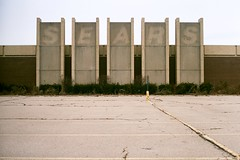 Former Salem Mall Sears (Travis Estell) Tags: 35mmfilm canonae1 deadmall deadretail film formersears fujisuperia400 labelscar montgomerycounty ohio salemmall sears searslabelscar thedarkroom trotwood vacantretail explored