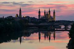 El Ebro por Zaragoza (Juan Ig. Llana) Tags: españa aragón zaragoza elpilar ebro reflejo cielo atardecer puentedehierro arquitectura basílica agua río explore