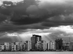 Västerås skyline (marcusholmqvist) Tags: monochrome monochromatic hamn harbour dock bay water sjö lake västerås västmanland clouds building buildings cityscape architecture rays sunbeams sunray sunrays
