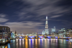 20170406_F0001: Colourful river (wfxue) Tags: london bridge londonbridge millenniumbridge towerbridge thames river water shore boat shard theshard glass building hall structure night sky light trails plane airplane cloudy windy city longexposure