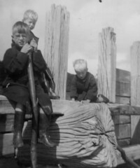 Outing to Hastings (theirhistory) Tags: boy child kid raincoat wellies rubberboots sandals beam wood groyne glasses