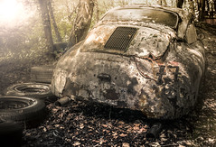 You can kiss my ass.. (Marco Bontenbal (Pixanpictures.com)) Tags: nikon d7100 decay decayed car porsche old technology sigma 1835 natural light lost photography pixanpictures europe world germany eu urbex urban ue urbanexploring tire rear 77 woods naturallight beautiful forgotten hidden sportscar rusted