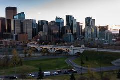 Big City Lights: Calgary Series 'A' (Image 2) (Martin Thielmann) Tags: ab bowriver centrestreetbridge memorialdrive carlighttrails sunsetbehindcalgaryskyline trafficonroads viewfromhillside
