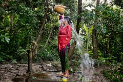 (unicefindia) Tags: bathing handpump india ruralarea watercontainer women