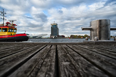 Looking over IJ (near Amsterdam Central Station) (PaulHoo) Tags: amsterdam city holland netherlands urban nikon d700 2017 wideangle ij eye filmmuseum boat ship red yellow steiger port water cityscape line perspective sky clouds