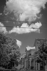clouds, architecture, trees, off Jefferson Avenue, New Orleans, Louisiana, Nikon D40, nikon nikkor 55mm f-3.5, 4.21.17 (steve aimone) Tags: neworleans louisiana archtecture residences trees clouds jeffersonavenue nikond40 nikonnikkor55mmf35 nikonprime primelens blackandwhite monochrome monochromatic powerlines
