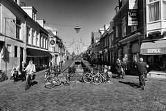 Bycicle Race In A Pedestrian Area (Alfred Grupstra) Tags: sneek friesland nederland nl people blackandwhite street urbanscene city citylife architecture outdoors bicycle buildingexterior traveldestinations tourism travel town builtstructure europe editorial citystreet tourist cultures