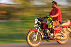 "Wear Helmet, Ride Safe! (""The Wanderer's Eye Photography"") Tags: road street city travel urban orange india man motion blur color macro art bike sport speed canon poster eos interesting movement track driving view ride traffic zoom body candid parts side bangalore transport blurred scene safety motorbike dirt gaming riding enjoy rush transportation need motorcycle shake commuter motor pan safe unusual traveling dslr karnataka sporting panning rider icm goldenhour digitalphotography ind brightly trafficsafety creativeblur blurmotion intentionalcameramovement canoneos450d bangaloretrafficpolice bangalorephotographers canoneosrebelxsi rubenalexander thewandererseye"