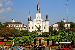St. Louis Cathedral - New Orleans (kl Smith) Tags: new travel blue trees red vacation sky horses horse plants usa brown green church colors beautiful architecture landscape orleans colorful colours carriage cathedral flag united neworleans scenic states colourful stlouiscathedral horsedrawncarriage