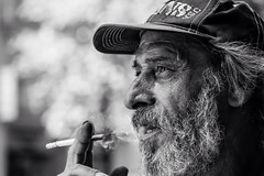 Living the street life one cigarette after another (Giulio Magnifico) Tags: life sunlight hat beard living cigarette profile citylife streetphotography streetportrait streetlife smoker udine nikond800 nikkormicro105mmafsvrf28
