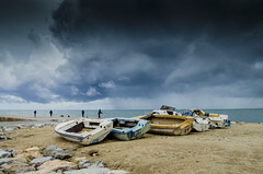 Fishing and boats (ray_anthony) Tags: ocean barcelona sea beach water clouds boats pier fishing sand rocks gloomy fishermen