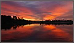 X marks the spot (WanaM3) Tags: park reflection nature water silhouette sunrise texas sony ngc bayou pasadena mirrorimage a57 bayareapark armandbayou wanam3 sunrays5 sonya57