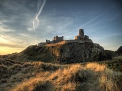 Bamburgh Castle at dawn (neilalderney123) Tags: ©2017neilhoward bamburgh landscape dawnhistory arcitecture olympus omd