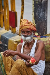 Old baba receiving alms and fruit on the street~ Varanasi (~mimo~) Tags: fruit watermelon documentary travel asia hindu religion color portrait photography street swami baba ganges varanasi india