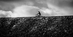 Morning Bike Ride (mcook1517) Tags: biking bike morning sunrise rocks gravel travel tourism city urban clouds losangeles santafedam monochrome blackandwhite people