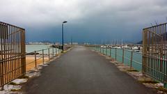 ENTRADA AL PUERTO (agustincordoba_g) Tags: puertas aire puerto rejas mar marina nubes nublado agustin cordoba arte