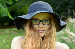 The spell. (pstone646) Tags: beauty portrait people youngwoman younglady pretty redhead hat glasses outdoors blueeyes