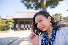 Young woman taking selfie picture in temple of Kyoto, Japan (Apricot Cafe) Tags: img30621 2024years asia asianandindianethnicities hyakumanbenchionjitemple japan japaneseethnicity kyotocity kyotoprefecture sigma20mmf14dghsmart casualclothing charming cheerful citylife closeup day enjoyment freedom freshness happiness horizontal humanface lifestyles oneperson onlywomen outdoors photography portrait relaxation selfie smiling springtime temple tourism tourist traveldestinations waistup walking weekendactivities women youngadult religion