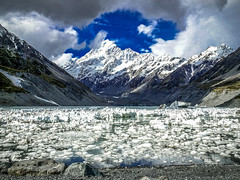 Glacier lake in Hooker Valey (Lanceflot) Tags: aoraki mount cook summit newzealand south island moutain landscape rock lake glacier ice water sky clouds snow breathtaking colorful