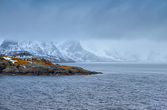 Travel and Tourism Concepts. One Separate House on Seashore Coastline in Norway Against Mountains Covered With Snow. (DmitryMorgan) Tags: norway norwegian panorama scandinavia arctic bay coast environment europe fjord hamnoy harbor house hut isle light lofoten lofotenislands mountains nature nopeople noone ocean outdoor picturesque polarcircle red reddish reine reinefjord scenery scenic seascape snowy traditional traveldestination travelling village water