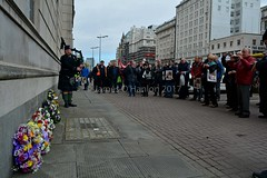 A lone piper plays as the wreaths have just been laid (James O'Hanlon) Tags: international workers memorial day internationalworkersmemorialday service liverpool 2017 malcolmkennedy deputy mayor cllr malcolm kennedy wreath public pier head georges dock mersey tunnel