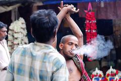 Smoke gen (Rajib Singha) Tags: travel street people portrait smoking habit market vendor interestingness flickriver nikond200 tamronadaptall270150mmf35lens mallikghatflowermarket kolkata westbengal india