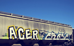 ACER - ERASE (Electric Funeral) Tags: railroad art by digital train canon photography graffiti midwest nebraska paint railway iowa fremont kansascity railcar missouri acer lincoln kansas traincar omaha graff aerosol goonies hopper freight erase desmoines freighttrain councilbluffs gns benched benching xti freighttraingraffiti
