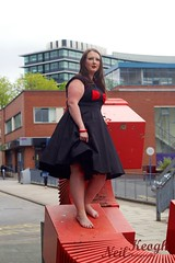 IMG_4464 (Neil Canon Keogh) Tags: red black vintage necklace highheels dress retro ring redhead bow buskers bracelet heels rockband pinup pinupgirl trianglesquare manchestercitycenter dressmodellaura